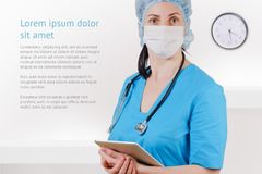 Medical doctor with stethoscope and tablet isolated on white background. Nurse with surgical mask, uniform and hat. Medical doctor with stethoscope and tablet stock images