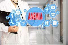 Medical Doctor with stethoscope and word ANEMIA, aplastic anemia royalty free stock image