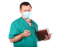 Medical doctor with stethoscope writing Royalty Free Stock Photos
