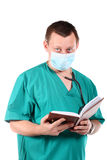 Medical doctor with stethoscope writing Stock Image