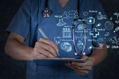 Medical doctor with stethoscope writing Stock Photos