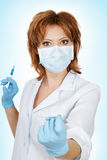 Medical doctor with syringe Stock Photography