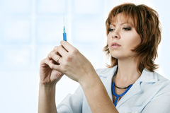 Medical doctor with syringe. Isolated over white background Stock Photos