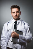 Medical doctor with tablet pc portrait Stock Images