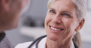 Medical doctor talking with male patient Stock Photo