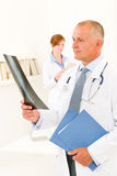Medical doctor team male look at x-ray Stock Photo