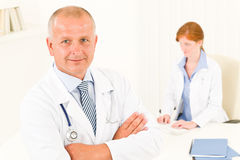 Medical doctor team senior male young woman Royalty Free Stock Images