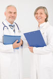 Medical doctor team seniors smiling hold folders Stock Image