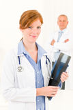 Medical doctor team young female hold x-ray Royalty Free Stock Images
