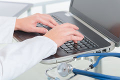 Medical doctor typing on laptop Royalty Free Stock Photo