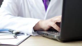 Medical doctor using his laptop at work. 4K UltraHD video stock video
