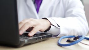 Medical doctor using his laptop at work. 4K UltraHD video stock footage