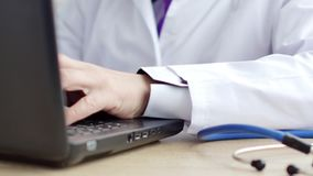 Medical doctor using his laptop at work. 4K UltraHD video stock video footage