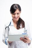 Medical doctor using tablet computer Royalty Free Stock Photography