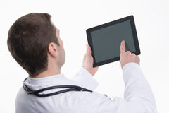 Medical doctor using tablet pc with empty screen Stock Photo
