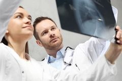 The medical doctor is watching the X-ray royalty free stock photo