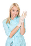 Medical doctor in white medical gloves. Royalty Free Stock Images