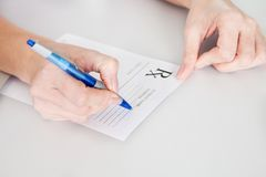 Medical doctor woman filling out prescription Stock Photography