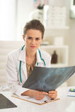 Medical doctor woman with fluorography in office Stock Photography