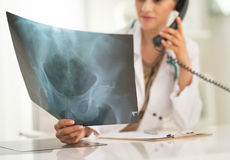 Medical doctor woman looking on fluorography Royalty Free Stock Photo
