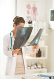 Medical doctor woman looking on fluorography Stock Photos