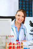 Medical doctor woman looking out from monitor Royalty Free Stock Image
