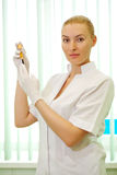 Medical doctor woman looking on test tube with blood Royalty Free Stock Photo