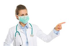 Medical doctor woman pointing on copy space Royalty Free Stock Photography