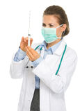 Doctor woman with syringe preparing injection Royalty Free Stock Images