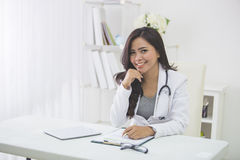 Medical doctor woman in the office. Smiling medical doctor woman in the office Royalty Free Stock Images