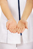 Medical doctor woman with open hands. Stock Images