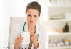 Medical doctor woman pointing on prescription Royalty Free Stock Image