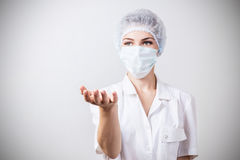 Medical doctor woman showing empty hand. Stock Photography