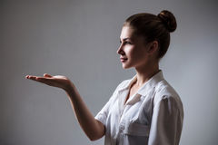 Medical doctor woman showing empty hand. Stock Images