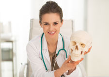 Medical doctor woman showing human skull Royalty Free Stock Images