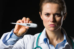 Medical doctor woman showing thermometer Stock Photo