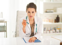 Medical doctor woman sitting in office Royalty Free Stock Photography