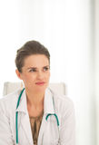 Medical doctor woman sitting in office Stock Photos