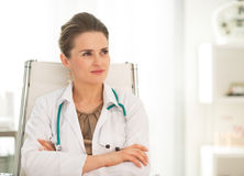 Medical doctor woman sitting in office Royalty Free Stock Photo