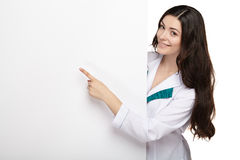 Medical doctor woman smile hold blank card board Stock Image