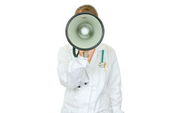 Medical doctor woman speaking into megaphone. Medical doctor woman standing in front of camera and speaking into megaphone isolated on white Royalty Free Stock Photos