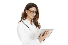 Medical doctor woman with stethoscope and laptop pc Stock Photos