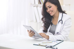 medical doctor woman with stethoscope using tablet pc Royalty Free Stock Images
