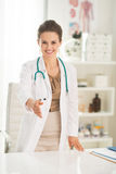 Medical doctor woman stretching hand for handshake Royalty Free Stock Photos