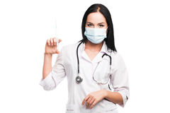 Medical doctor woman with a syringe Royalty Free Stock Photos