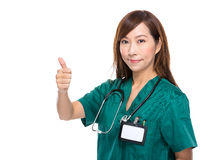 Medical doctor woman with thumb up Stock Photography