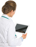 Medical doctor woman using tablet pc . rear view Stock Images