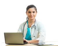 Medical doctor woman working with computer. Isolated over white background. Royalty Free Stock Photo