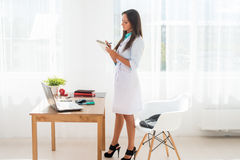 Medical doctor woman working in medical office. Stock Photo