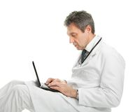 Medical doctor working on laptop Stock Image